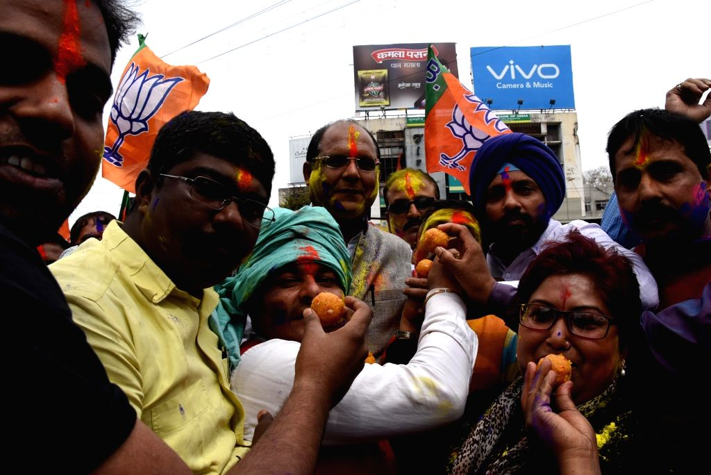 BJP supporters celebrate in Ranchi as assembly election results being declared on March 11, 2017.