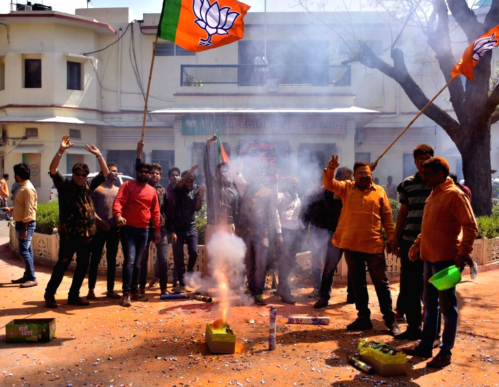 BJP supporters celebrate party's performance in the assembly elections in Jaipur on March 11, 2017.