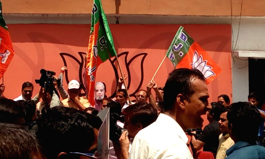 BJP supporters celebrating at the BJP central party office at New Delhi as the assembly election results being declared on May 19, 2016.