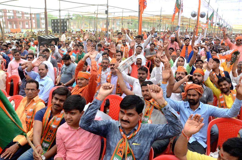 BJP supporters cheer during Prime Minister Narendra Modi's public rally in Pratapgarh, Uttar Pradesh on May 4, 2019. - Narendra Modi