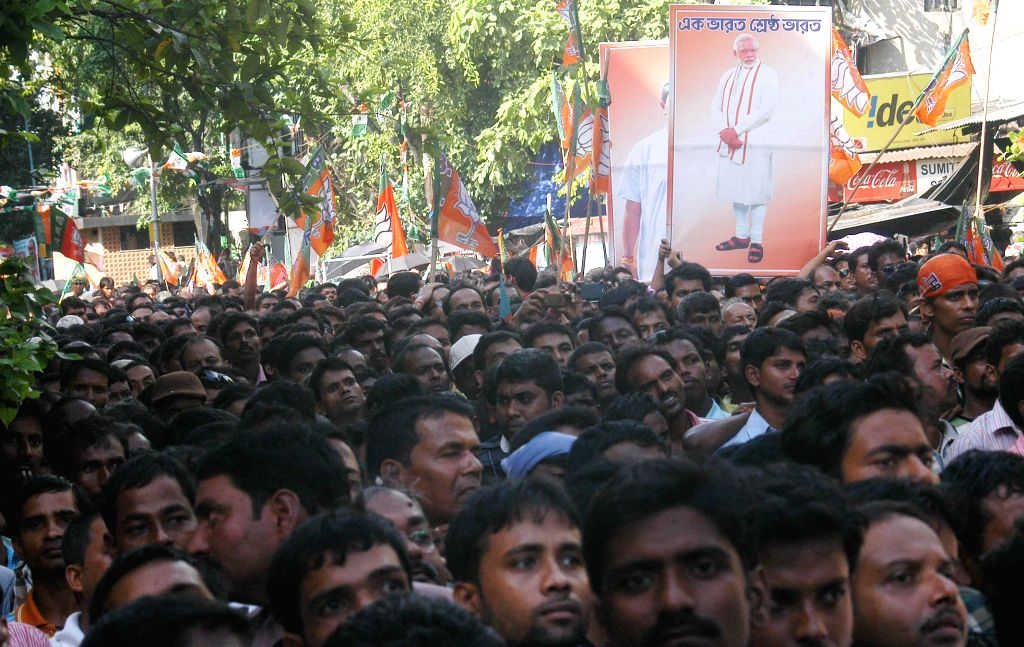 BJP supporters during a BJP rally where party chief Amit Shah campaigned for Ritesh Tiwari, party's candidate from Chowringhee assembly seat in Kolkata on Sept 7, 2014. - Amit Shah