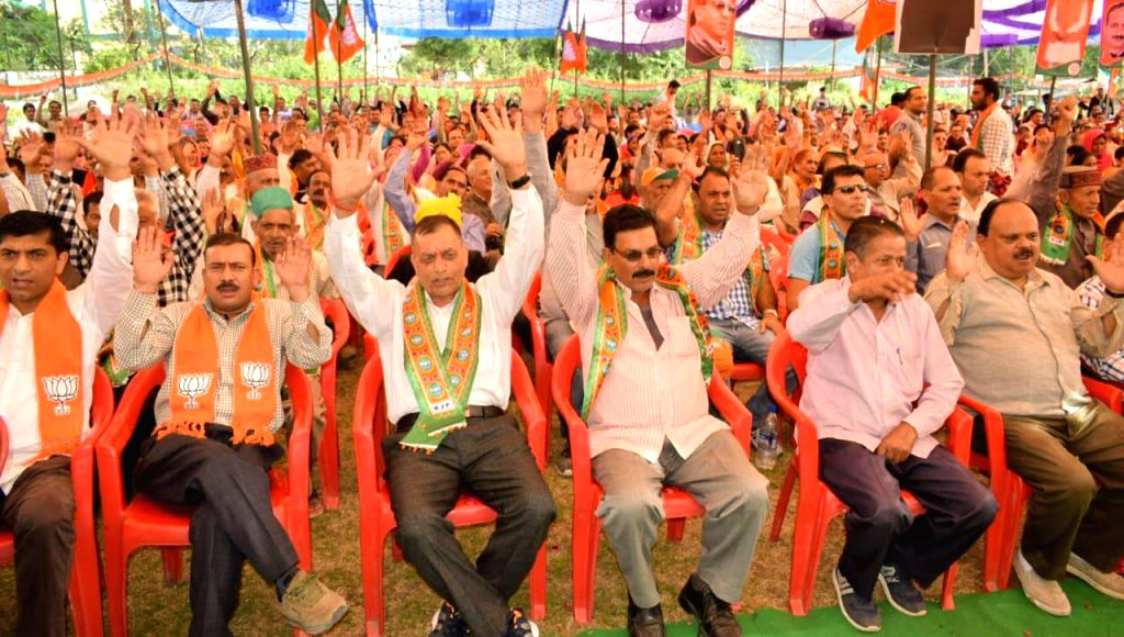 BJP supporters during an election rally organised in support of the party's candidate for the Dharamsala byelections, Vishal Nehriya, in Dharamsala on Oct 11, 2019.
