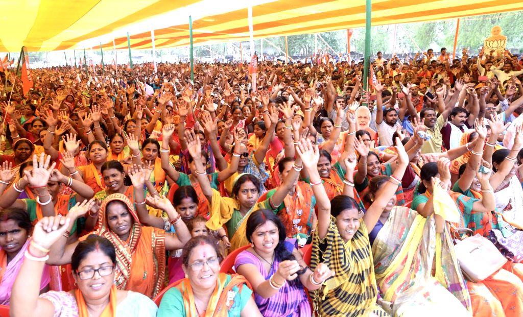 BJP supporters during party chief Amit Shah's public rally in Pakur, Jharkhand on May 11, 2019. - Amit Shah