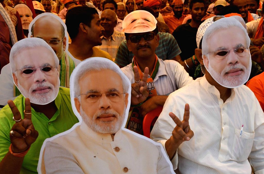 BJP supporters wearing face masks of Prime Minister Narendra Modi at party chief Amit Shah's public rally in Bihar's Begusarai, on April 24, 2019. - Narendra Modi and Amit Shah