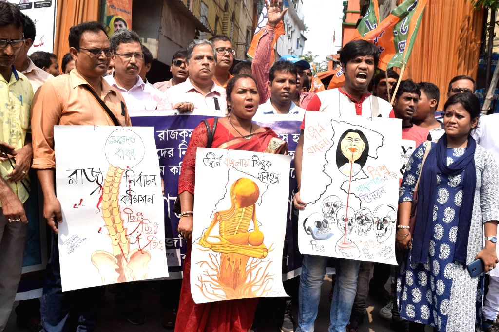 BJP teachers cell's members participate in protest rally against West Bengal Government in Kolkata on June 2, 2018.