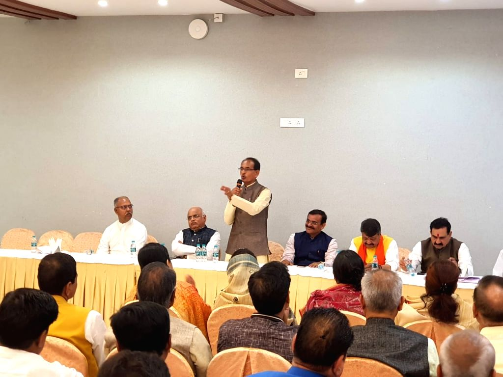 BJP Vice-President and former Madhya Pradesh Chief Minister Shivraj Singh Chouhan interacts with party MLAs, in Bhopal on March 20, 2020. - Shivraj Singh Chouhan
