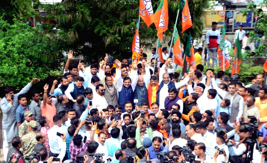 BJP Vice-President and former Madhya Pradesh Chief Minister Shivraj Singh Chouhan, party leader Kailash Vijayvargiya along with party workers celebrate as the BJP intensified the exercise to ... - Shivraj Singh Chouhan and Kamal Nath