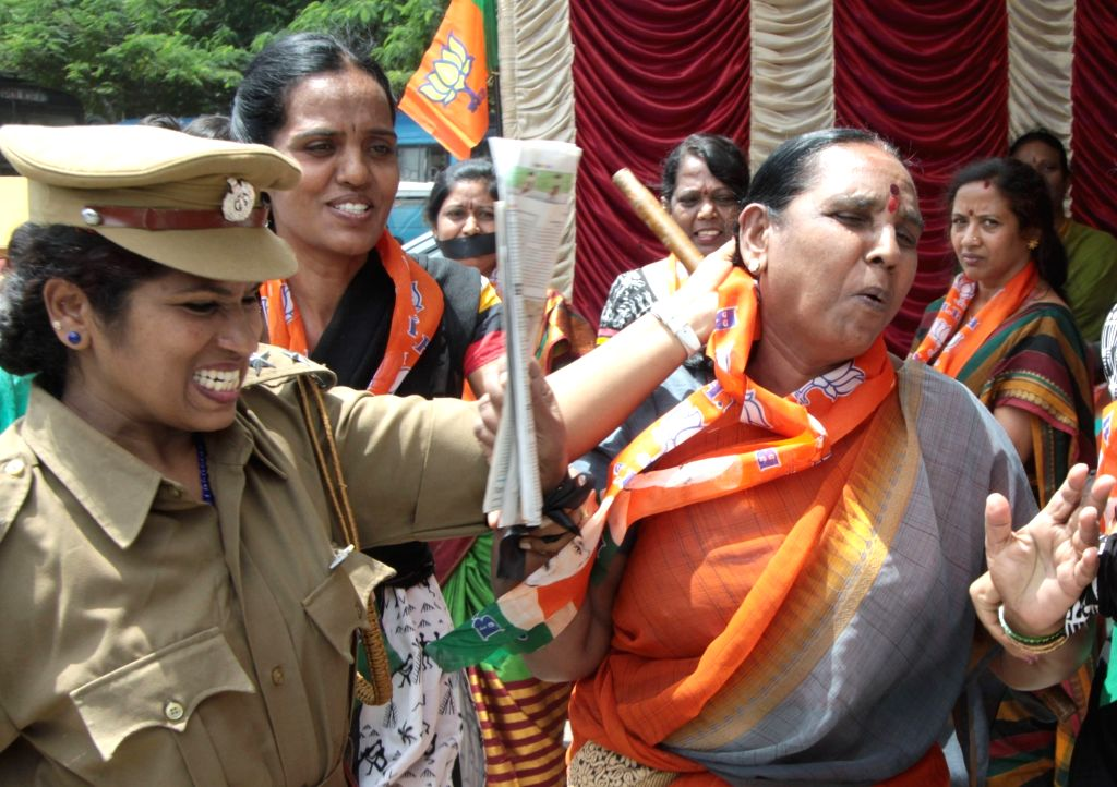 BJP women wing enact a play depicting the brutality on women agitators by police in Bengaluru on Aug 2, 2016.