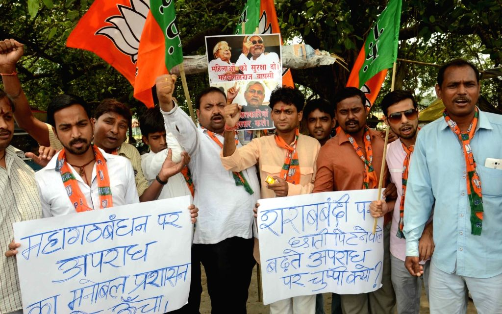 BJP worker stage a demonstration against the rising crime in Bihar; in Patna, on June 25, 2016.