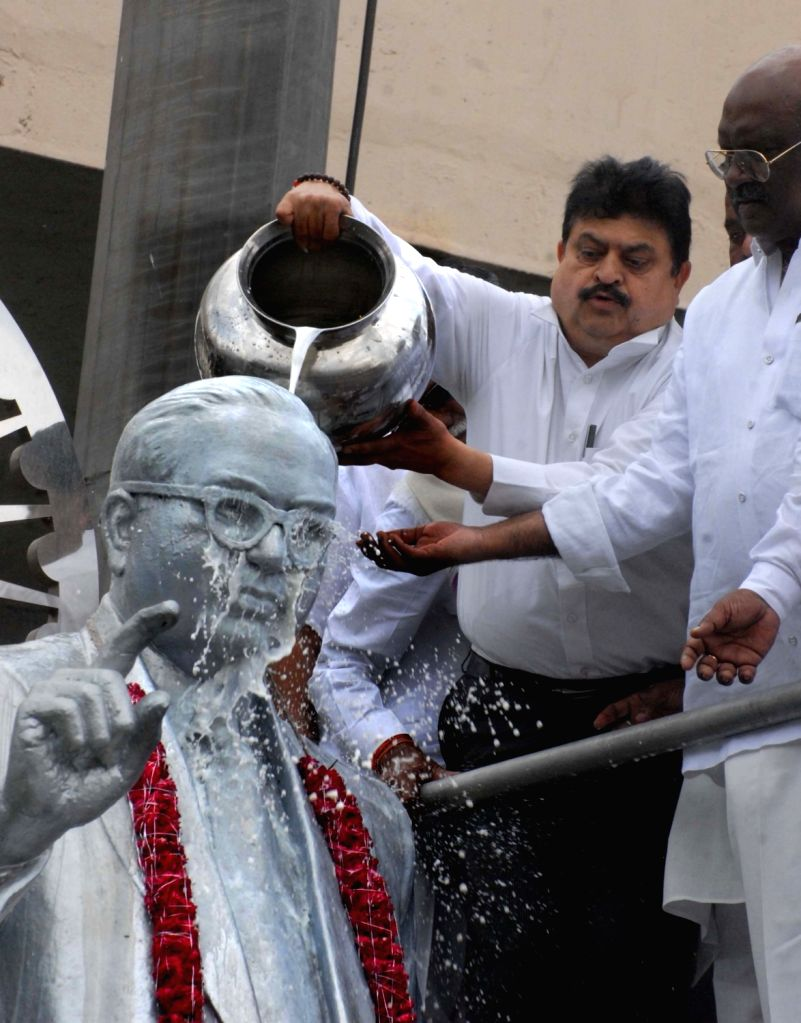 BJP workers bathe the statue of Dr B. R. Ambedkar with milk after the Rajya Sabha on Aug 6, 2018 unanimously passed the Constitution (One Hundred and Twenty-third Amendment) Bill as passed ...