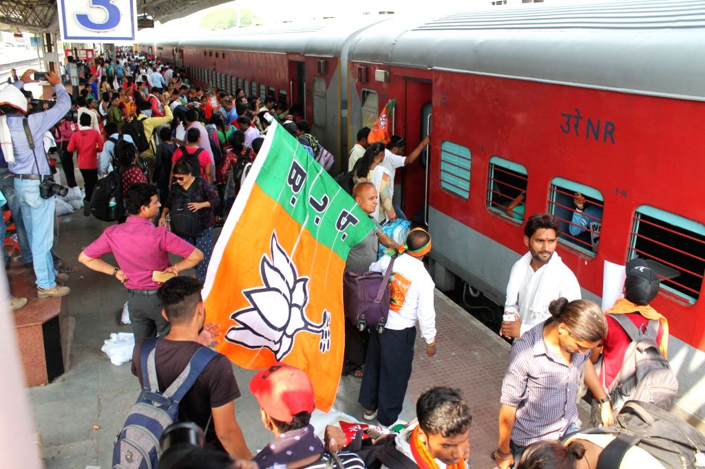 BJP workers board a train to attend the party's foundation day celebrations to be held in Mumbai on April 6; in Nagpur on April 5, 2018.
