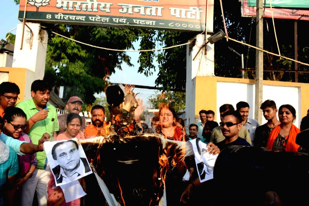 BJP workers burn an effigy of Samajwadi Party leader Mohd Azam Khan after the leader made objectionable remarks against Jaya Prada, the actor-turned-politician who is contesting from Rampur ... - Mohd Azam Khan
