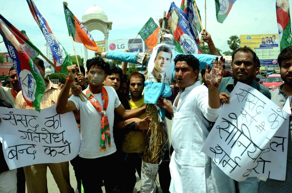 BJP workers burn effigies of Congress vice president Rahul Gandhi in Patna, on Aug 5, 2015.