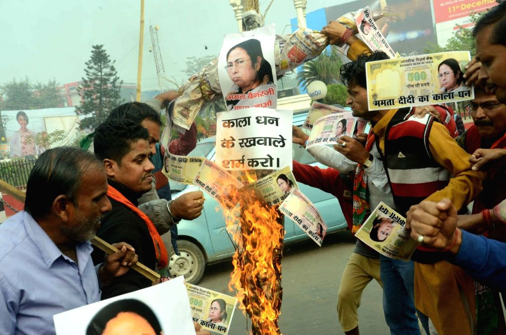 BJP workers burns an effigy of West Bengal Chief Minister and Trinamool Congress (TMC) supremo Mamata Banerjee in Patna on Nov 30, 2016. - Mamata Banerjee