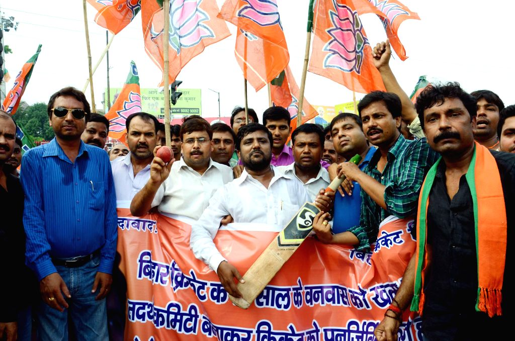 BJP workers celebrate after BCCI decided to form ad-hoc committees for Bihar in Patna, on Aug 8, 2015.