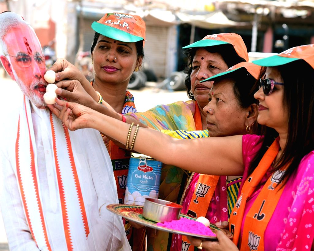 BJP workers celebrate after most exit polls showed the BJP-led NDA getting a comfortable majority in the recently concluded 2019 Lok Sabha elections, in Bikaner on May 20, 2019.