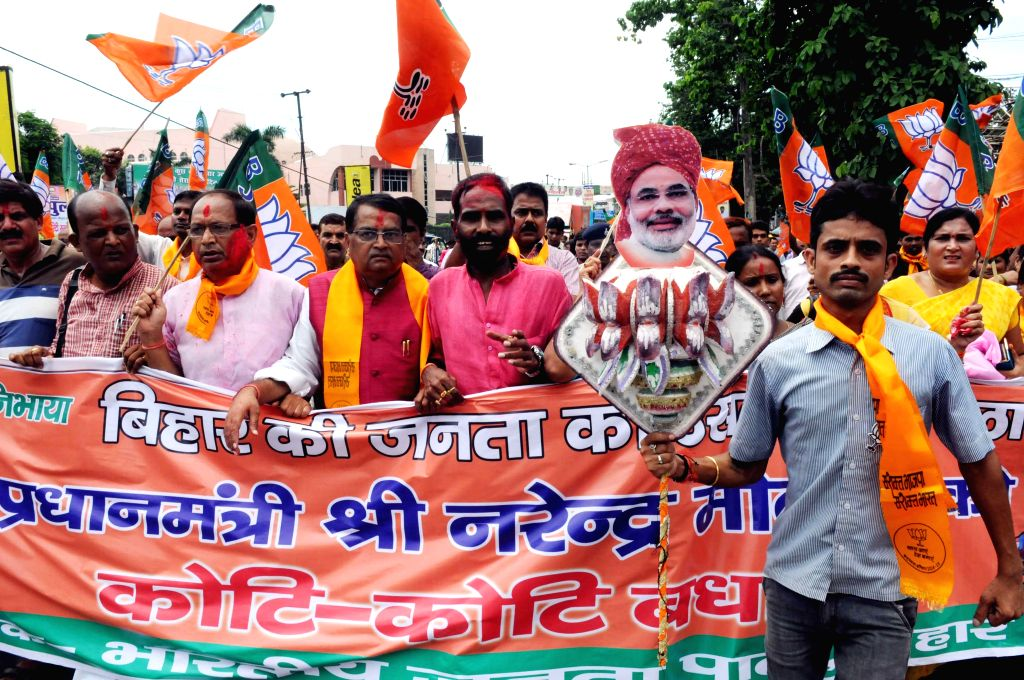 BJP workers celebrate after Prime Minister Narendra Modi announced special package for Bihar in Patna, on Aug 18, 2015. - Narendra Modi