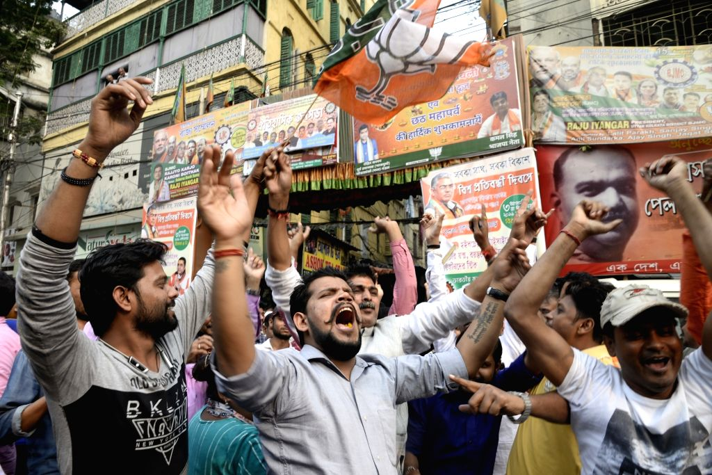 BJP workers celebrate after the Citizenship Amendment Bill (CAB) 2019 was passed in Parliament on Wednesday; in Kolkata on Dec 12, 2019.