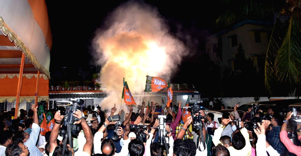 BJP workers celebrate after the party pulled off a stunning and historic victory in the 2019 Lok Sabha battle, at Odisha's BJP headquarters in Bhubaneswar, on May 23, 2019.