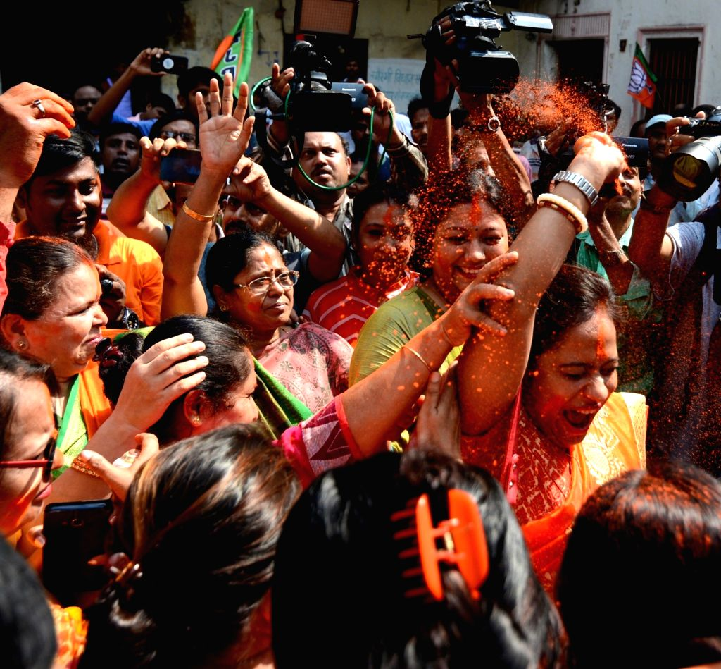 BJP workers celebrate after the party pulled off a stunning and historic victory in the 2019 Lok Sabha battle, at West Bengal BJP headquarters in Kolkata on May 24, 2019.