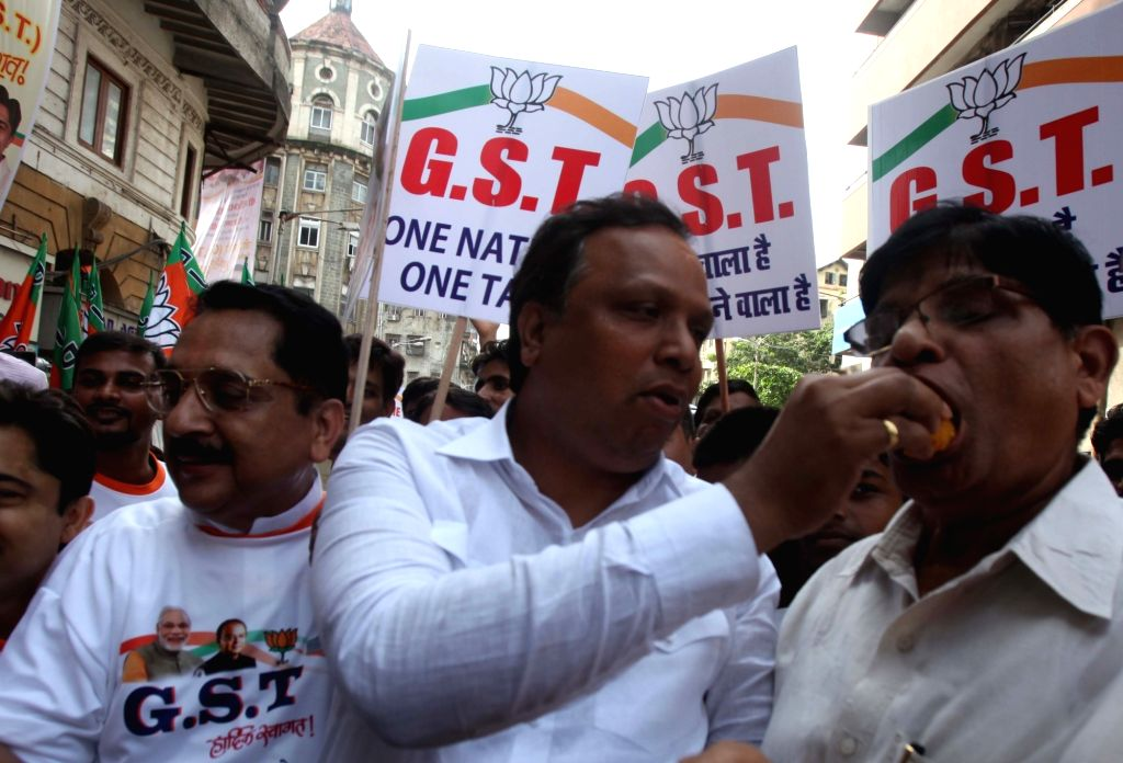 BJP workers celebrate ahead of roll-out of the historic Goods and Services Tax (GST) in Mumbai, on June 30, 2017.