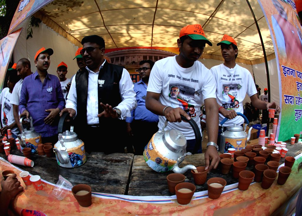 BJP workers celebrate as counting for 2014 Lok Sabha Election is underway and the party is leading nationally, in New Delhi on May 16, 2014.