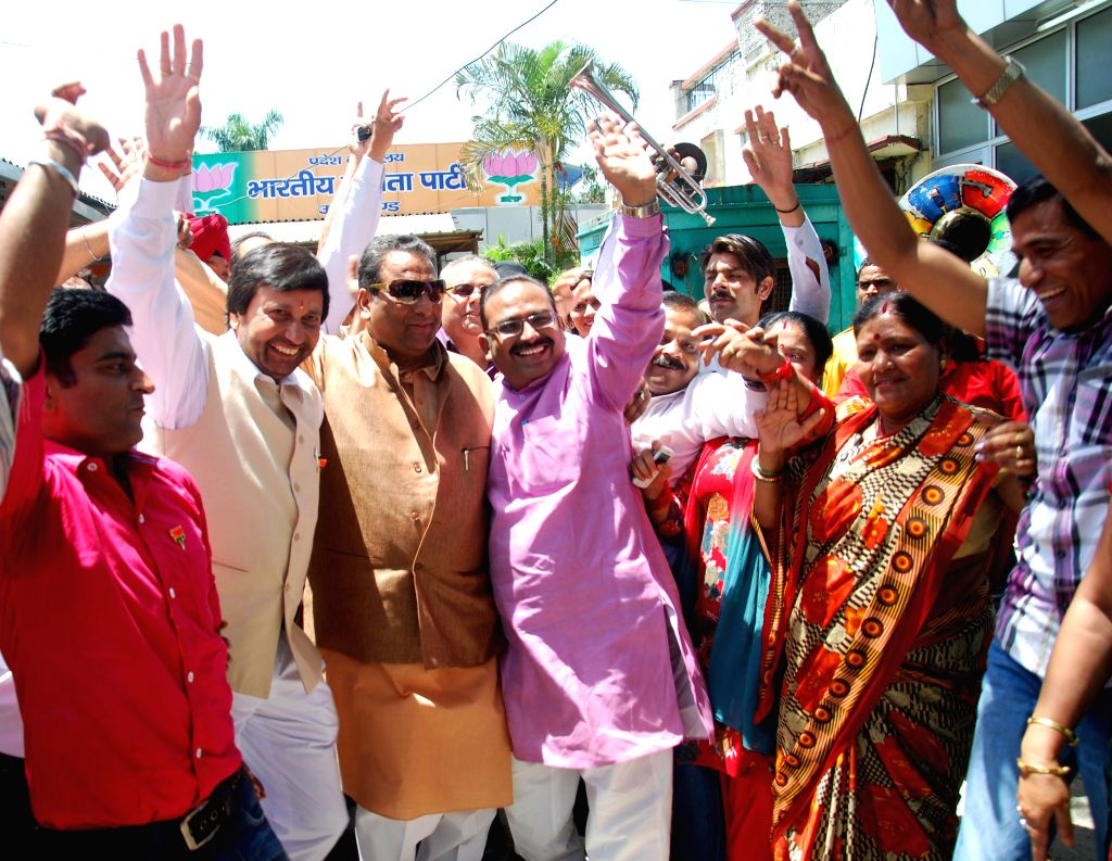 BJP workers celebrate party's performance in 2014 Lok Sabha Elections in Dehradun on May 16, 2014.