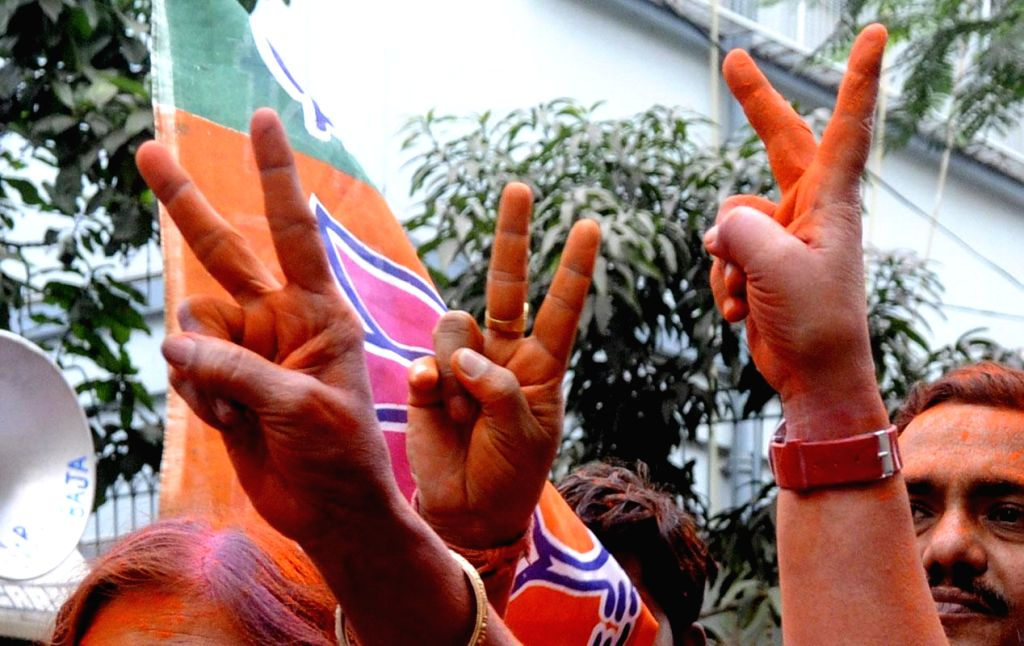 BJP workers celebrate party`s performance in the Assembly polls of Chhattisgarh, Madhya Pradesh, Rajasthan and Delhi in Kolkata on Dec.8, 2013.