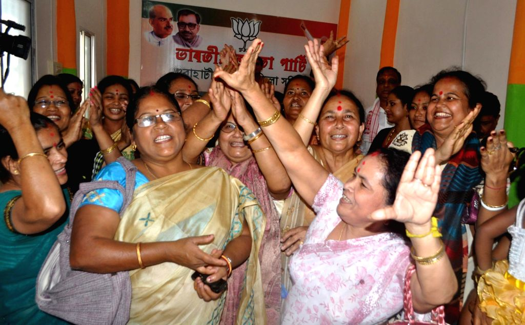 BJP workers celebrate party`s performance in the Assembly polls of Chhattisgarh, Madhya Pradesh, Rajasthan and Delhi in Guwahati on Dec.8, 2013.