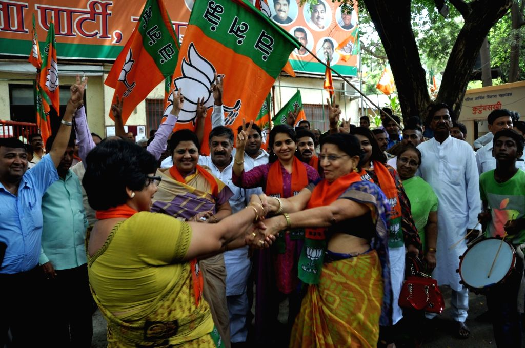 BJP workers celebrate party's performance in the recently concluded 2016 Assam assembly polls; in Mumbai, on May 19, 2016.