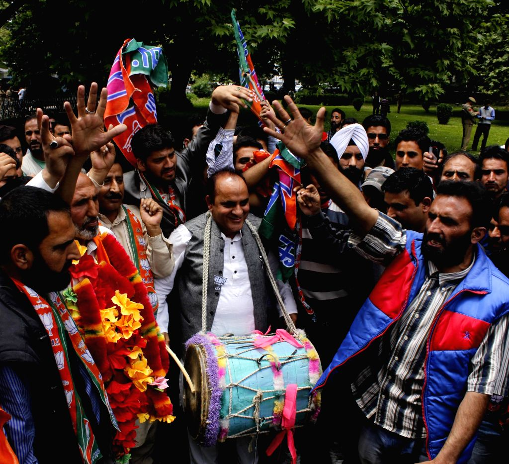 BJP workers celebrate party's win in 2014 Lok Sabha Elections in Srinagar on May 17, 2014.