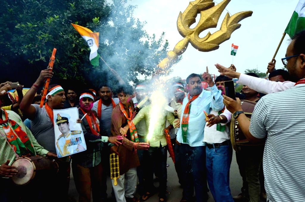 BJP workers celebrate the surgical strike by Indian Army along the Line of Control in Patna on Sept 30, 2016.