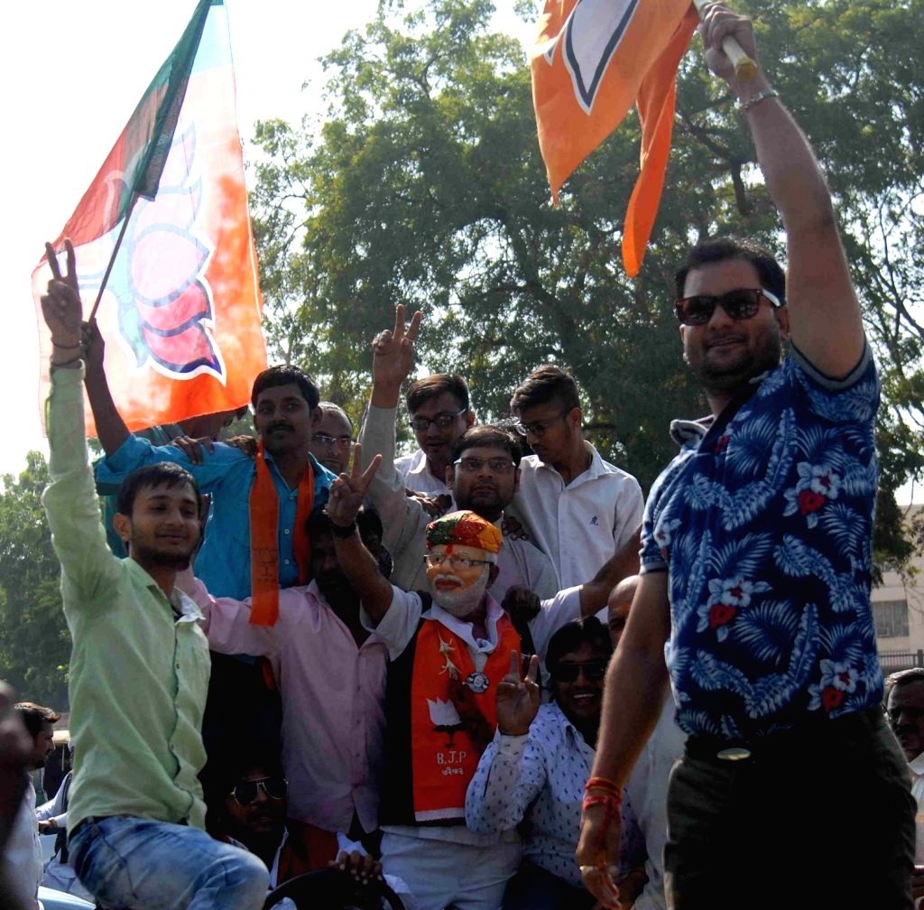 BJP workers celebrate their victory in the recently held Gujarat civic polls in Ahmedabad, on Dec 2, 2015.