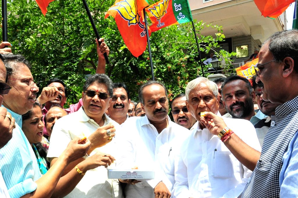 BJP workers celebrate three years of Modi Government in Bengaluru on May 26, 2017.