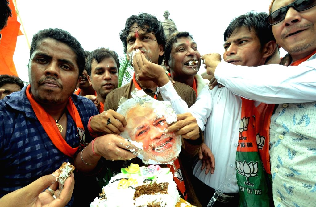 BJP workers celebrates on the eve of Prime Minister Narendra Modi's birthday in Patna on Sept 16, 2016. - Narendra Modi