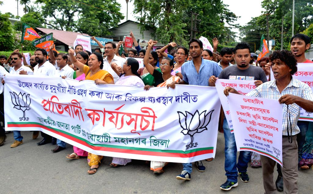BJP workers demonstrate against demolition drive of Kamrup Metropolitan district administration and to demand shelter for those who were displaced during the drive in Guwahati on July 9, 2014.