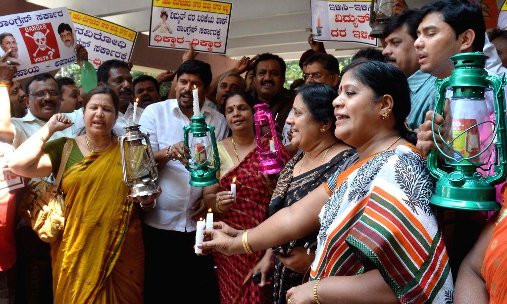 BJP workers demonstrate against hike in power tariffs in Bangalore on May 13, 2014.
