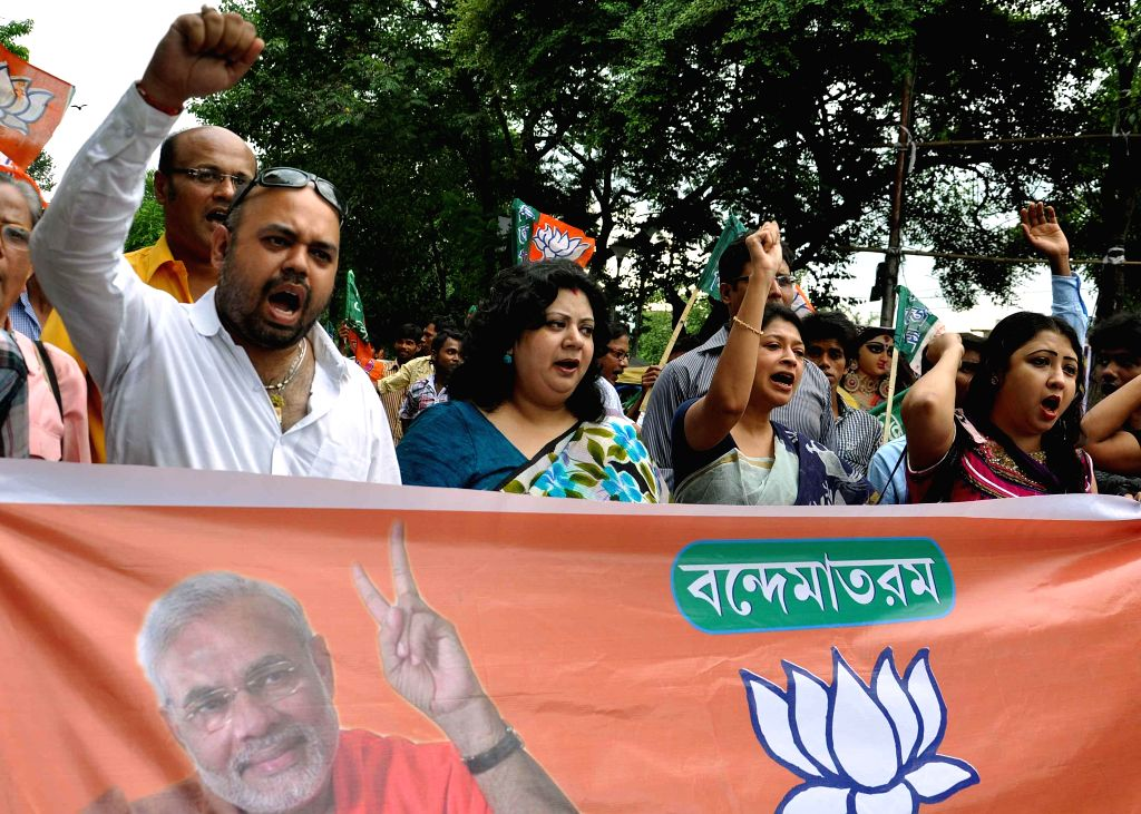 BJP workers demonstrate against Mamata Banerjee led West Bengal Government at Salt Lake in Kolkata on Sept 12, 2014. - Mamata Banerjee