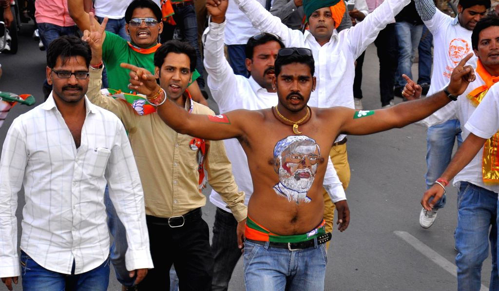 BJP workers during an election campaign rally ahead of Lok Sabha elections in Jaipur on April 12, 2014.