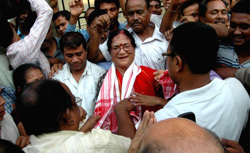 BJP workers greet party leader Bijoya Chakraborty after winning Guwahati Lok Sabha seat in Guwahati on May 17, 2014.