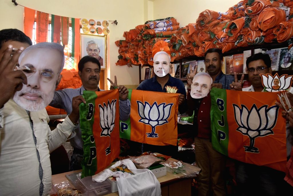 BJP workers holding party flags and Narendra Modi masks gear up for election campaign ahead of 2019 Lok Sabha polls in Ranchi on March 17, 2019. - Narendra Modi