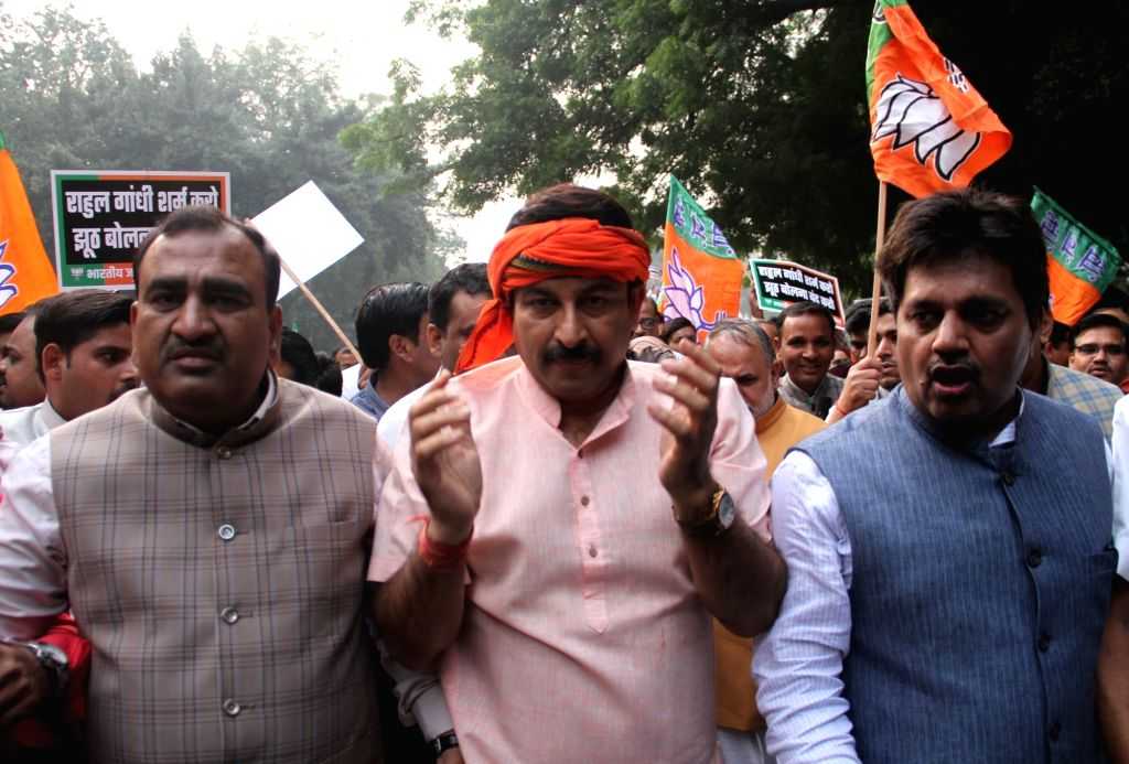 BJP workers led by Delhi party chief Manoj Tiwari, stage a demonstration outside the Congress headquarters demanding an apology from Rahul Gandhi over his remarks on the Rafale verdict, in ... - Rahul Gandhi
