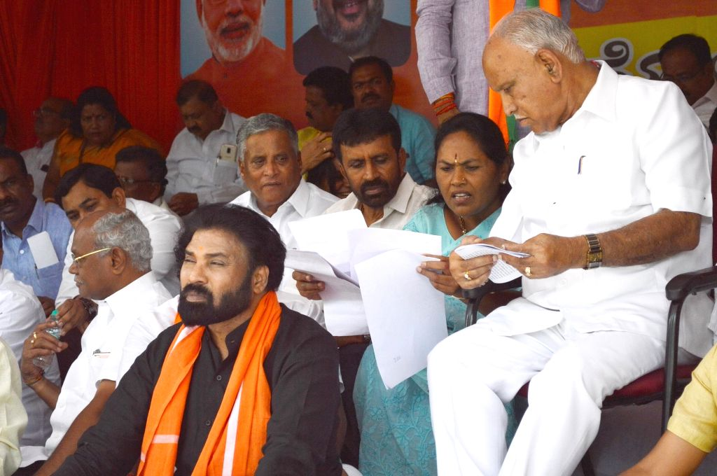BJP workers led by Karnataka party President B. S. Yeddyurappa, stage a demonstration against the state government over Jindal land deal, in Bengaluru on June 15, 2019.