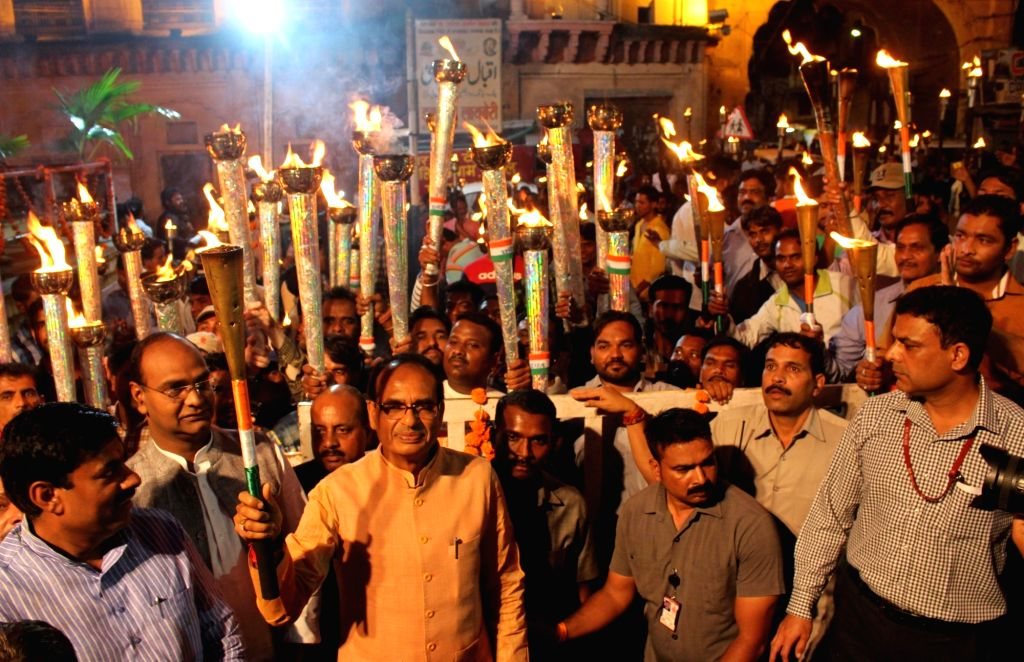 """BJP workers led by Madhya Pradesh Chief Minister Shivraj Singh Chouhan participate in """"Mashal Juloos"""" -torch rally- on the eve of Independence Day in Bhopal on Aug 14, 2016. - Shivraj Singh Chouhan"""