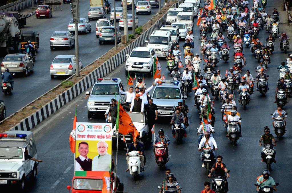 BJP workers led by Maharashtra Chief Minister and party leader Devendra Fadnavis takes out a bike rally ahead of the Lok Sabha polls, in Mumbai, on March 3, 2019.