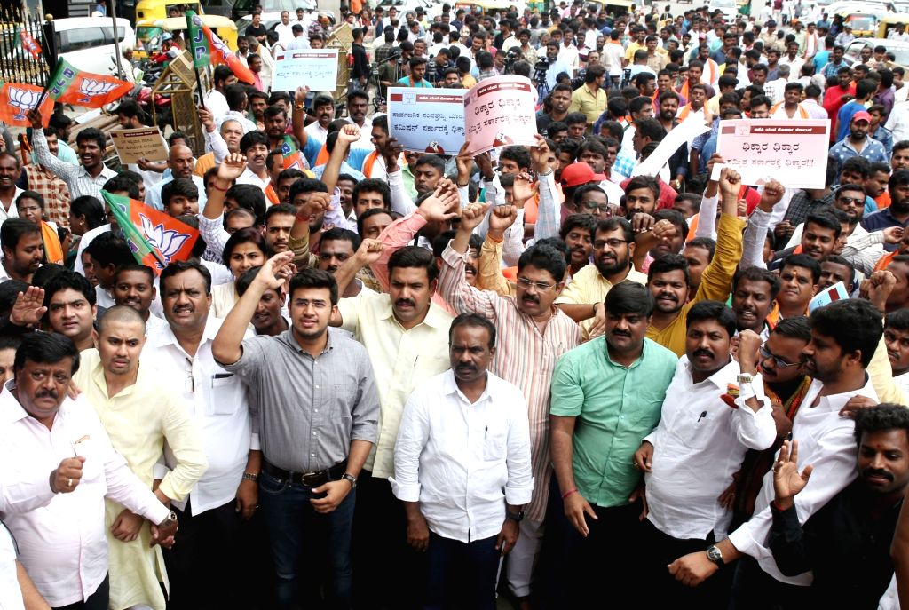 BJP workers led by party leader Tejasvi Surya stage a demonstration against the Karnataka Government for allotment of land to JSW Steel to set up a facility in Toranagallu of Ballari ...