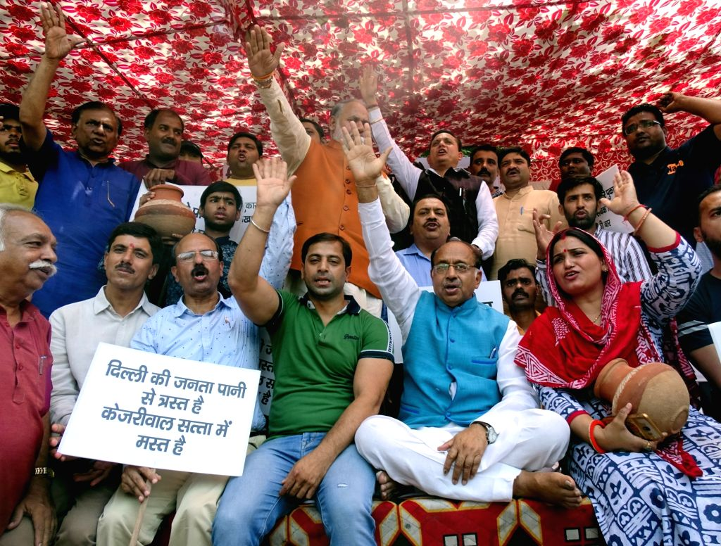 BJP workers led by party leader Vijay Goel, stage a demonstration against the Delhi Government over water crisis in the Capital, in New Delhi on June 4, 2019.
