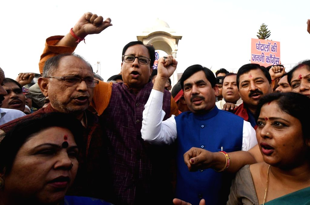 BJP workers led by party leaders Sanjay Jaiswal and Syed Shahnawaz Hussain, stage a demonstration against Congress and AAP, demanding apologies from Rahul Gandhi and Arvind Kejriwal over their ... - Rahul Gandhi and Arvind Kejriwal