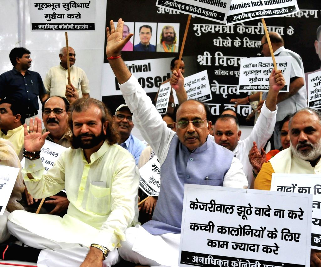 BJP workers led by party leaders Vijay Geol and Hans Raj Hans stage a demonstration against the Arvind Kejriwal-led Delhi Government for allegedly delaying the regularisation of ... - Arvind Kejriwal