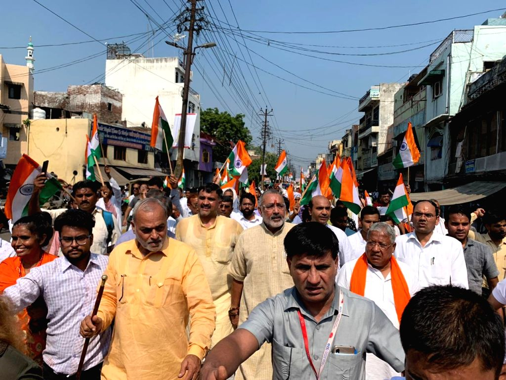 BJP workers led by Union Minister Giriraj Singh and party leader Ashwini Upadhay participate in a 3-day march to press for bringing legislation on a sensitive issue like population control, ... - Giriraj Singh